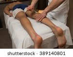 masseur doing massage on man... | Shutterstock . vector #389140801