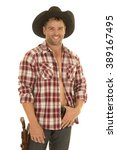 a cowboy in his plaid shirt... | Shutterstock . vector #389167495