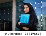 arab student holding a folder | Shutterstock . vector #389196619