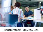 unposed group of creative... | Shutterstock . vector #389252221