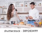 beautiful couple in the kitchen ... | Shutterstock . vector #389283499