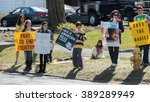 Small photo of Danbury, Connecticut, USA - March 11, 2016: Adult and young people hold signs protesting abortion
