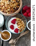 healthy snack   granola on... | Shutterstock . vector #389291671