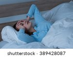 young woman suffering from... | Shutterstock . vector #389428087