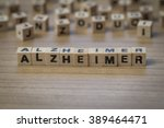 Small photo of Alzheimer (German Alzheimer's) written in wooden cubes on a table