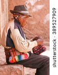 old men knitting at taquile... | Shutterstock . vector #389527909