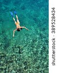 young woman snorkeling in...   Shutterstock . vector #389528434
