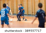 little boys playing soccer on... | Shutterstock . vector #389557717
