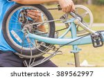 man is fixing bicycle | Shutterstock . vector #389562997