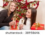 two young woman with champagne... | Shutterstock . vector #38958646