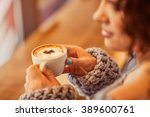 pleasant woman drinking coffee  | Shutterstock . vector #389600761