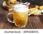 glass mug of draft light beer... | Shutterstock . vector #389608051