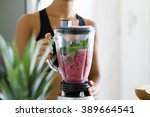 woman blending spinach  berries ... | Shutterstock . vector #389664541