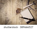 old brass compass on wood table ... | Shutterstock . vector #389666527