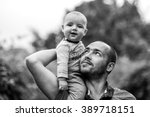 Child Sits On Dad's Shoulder...