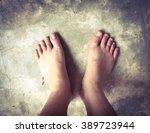 Bare Female Feet On Cement...