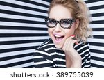 attractive surprised young... | Shutterstock . vector #389755039