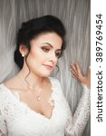 portrait of beautiful bride... | Shutterstock . vector #389769454