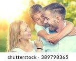 happy young family having fun... | Shutterstock . vector #389798365