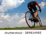 cyclist rides on asphalt road.... | Shutterstock . vector #389814985