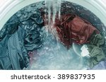 clothes in washing machine | Shutterstock . vector #389837935