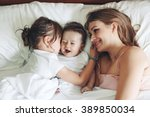 young mom with her 5 years old... | Shutterstock . vector #389850034