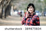 woman portrait in the park with ... | Shutterstock . vector #389875834
