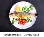 Plate Of Baked Sea Bass On Dar...