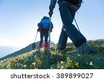 hiking in mountains | Shutterstock . vector #389899027