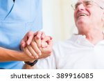Nurse Holding Hand Of Senior...