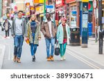 group of young friends walking... | Shutterstock . vector #389930671