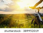 Lady With Bicycle On A Rural...