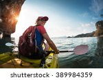 Woman Paddling The Sea Kayak I...