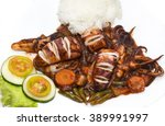 squid grilled with vegetables...   Shutterstock . vector #389991997