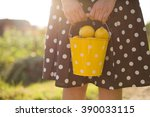 woman in a brown dotted dress... | Shutterstock . vector #390033115