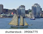 HALIFAX - JULY 20: Tall ships in Halifax Harbor during the parade of sail on July 20, 2009 in Halifax, Nova Scotia, Canada. - stock photo