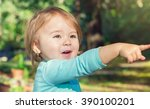 happy toddler girl playing... | Shutterstock . vector #390100201