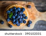 blueberry pancakes on rustic... | Shutterstock . vector #390102031