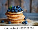 blueberry pancakes on rustic... | Shutterstock . vector #390102055