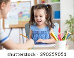 woman helping her daughter with ... | Shutterstock . vector #390259051