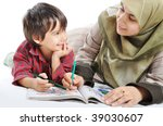 Cute child is painting and playing with his mother - stock photo