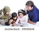 Cute children are painting and playing with their father and mother - stock photo