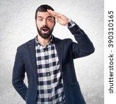 handsome man showing something   Shutterstock . vector #390310165