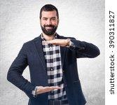 handsome man holding something | Shutterstock . vector #390311827