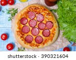 hot homemade pepperoni pizza on ... | Shutterstock . vector #390321604