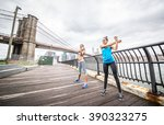 sportive girls stretching and... | Shutterstock . vector #390323275