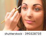 applying eyebrow products in... | Shutterstock . vector #390328735