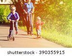 Mother With Kids Riding...