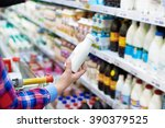 woman shopping dairy product in ... | Shutterstock . vector #390379525