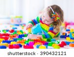 preschooler child playing with... | Shutterstock . vector #390432121